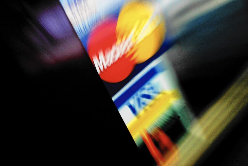 In some cases, credit card issuers are unilaterally raising credit limits on certain customers without them even having to apply, one expert said.