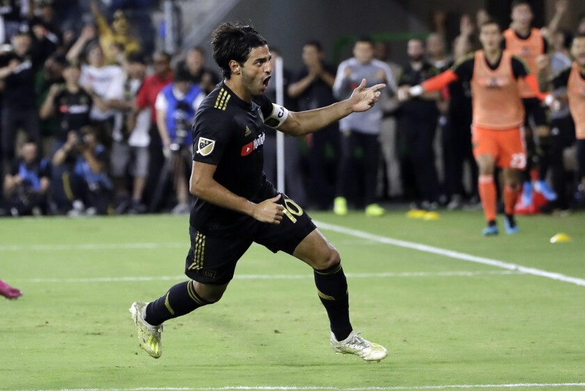 Carlos Vela LAFC celebrates after scoring against the Galaxy during the second half of a 3-3 Sunday tie.
