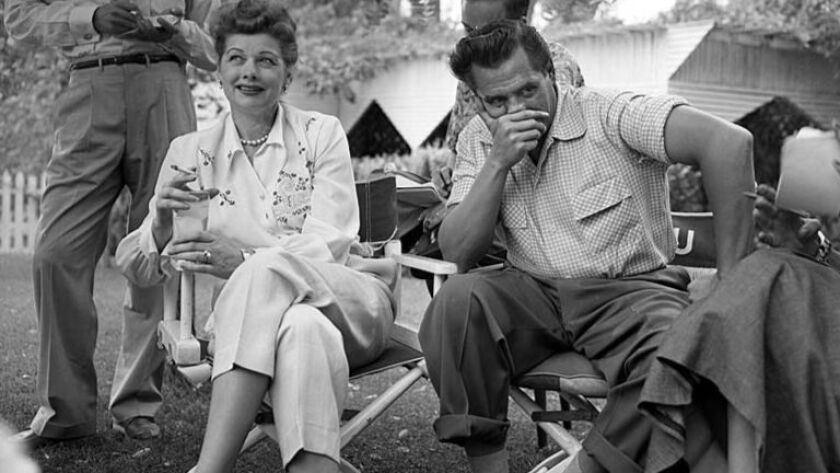Sep. 12, 1953: Actress Lucille Ball laughs as her husband, Desi Arnaz, contemplates an answer at the
