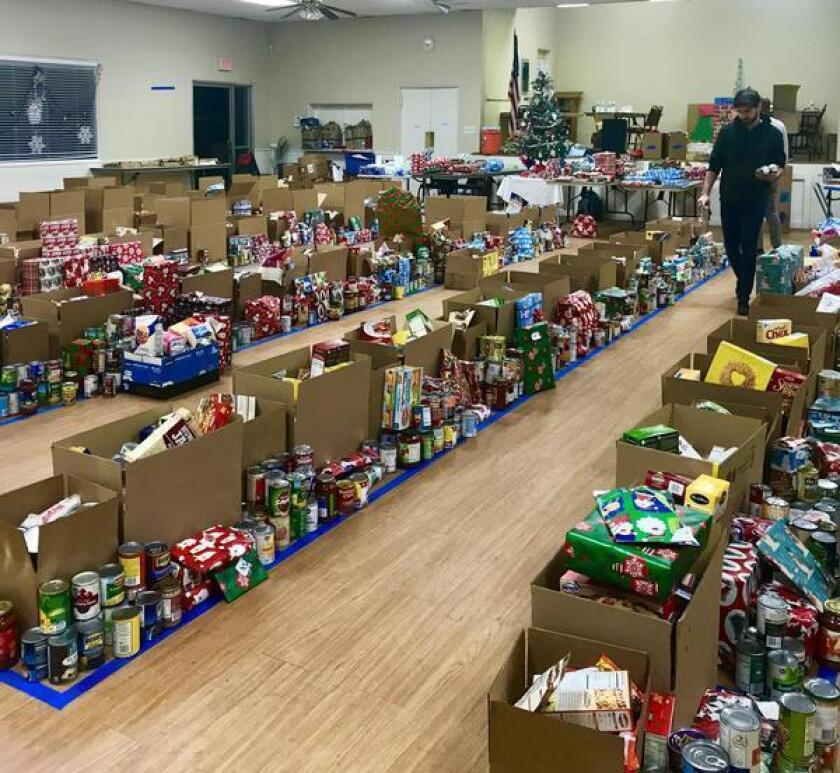 This image from a past Ocean Beach Holiday Toy & Food Drive shows the scope of preparations, after volunteers left the Masonic Lodge for the night.