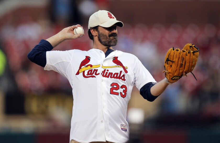 Missouri native Jon Hamm throws out a ceremonial first pitch before the Monday night game between the St. Louis Cardinals and the Cincinnati Reds in St. Louis.