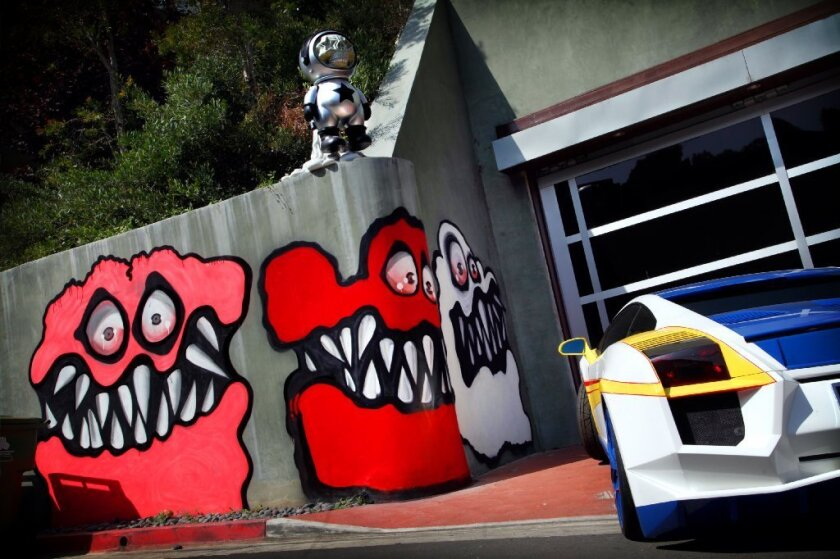 Neigbors are angry at entertainer Chris Brown's street art painted outside his Hollywood Hills home.
