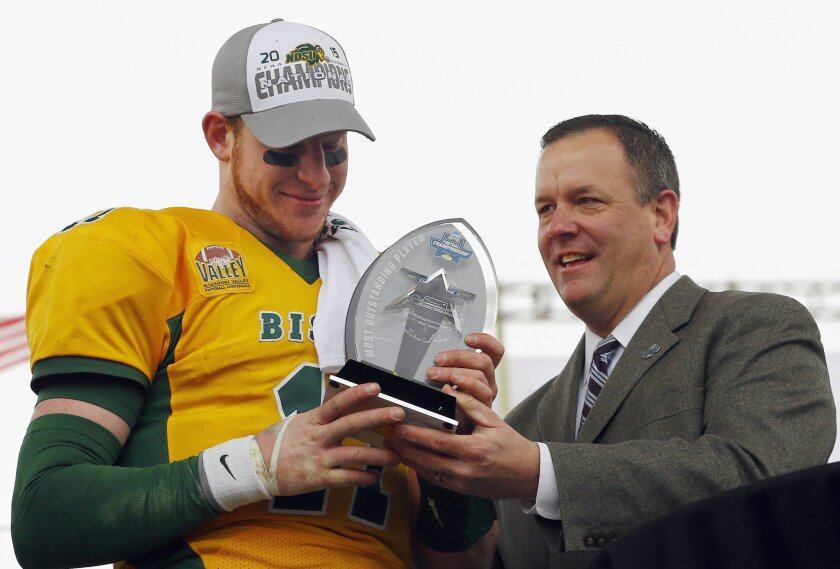 FILE - In this Jan. 9, 201, 6 file photo, North Dakota State quarterback Carson Wentz accepts the trophy for the most valuable player after NDSU beat Jacksonville State 37-10 in the FCS championship NCAA college football game in Frisco, Texas. North Dakota State football coaches enjoyed some free a