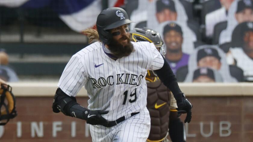 Colorado Rockies right fielder Charlie Blackmon hits the ball.