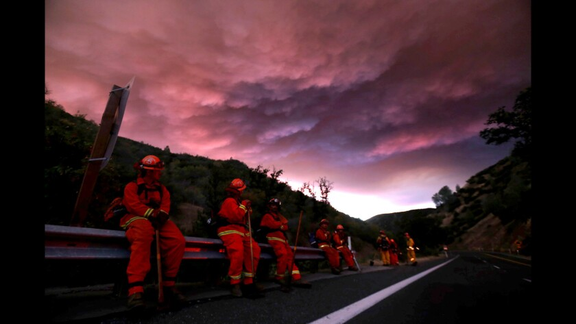 Firefighters hold a line along California 20 in Clear Lake to make sure the fire doesn't double back. About 12,000 people have been told to evacuate their homes and campgrounds. The fire was 5% contained.