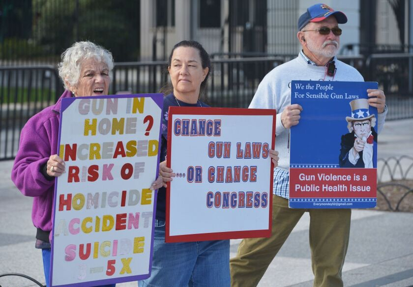 Demonstrators take part in a rally calling for sensible gun laws in front of the White House on October 5, in Washington.