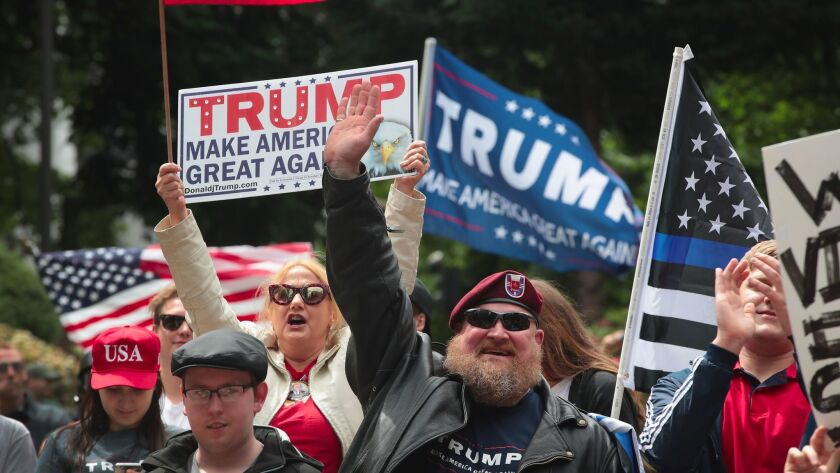 "Pro-Trump demonstrators rally on June 4, 2017 in Portland, Oregon. The protest dubbed ""Trump Free Speech."""