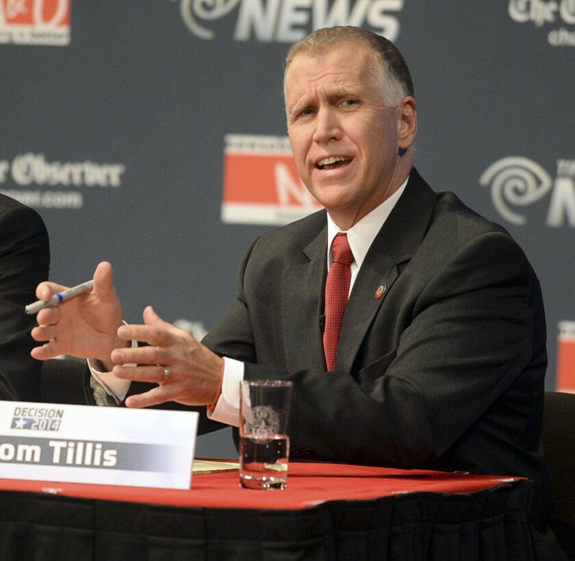 Republican senatorial candidate Thom Tillis answers a question during a debate at Davidson College in Davidson, N.C., Tuesday, April 22, 2014. (AP Photo/Charlotte Observer, Todd Sumlin, Pool)