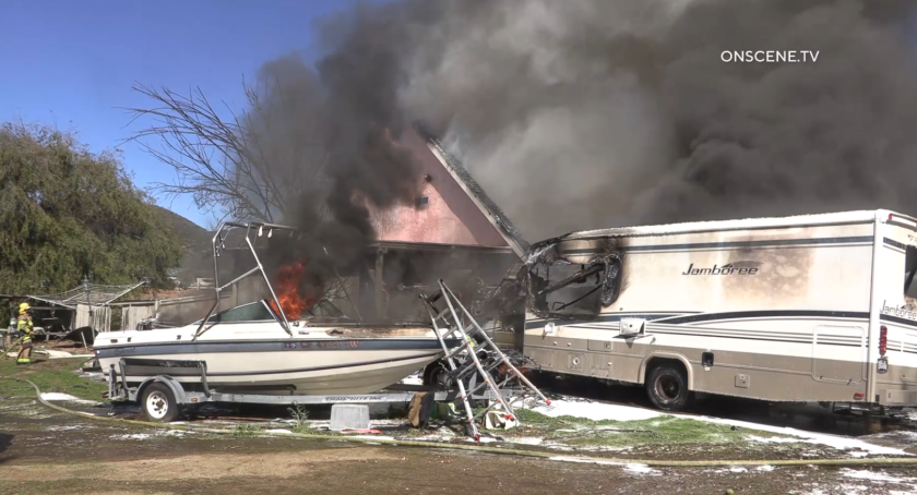 A fire damaged a house, RV and boat in Jamul Monday afternoon.
