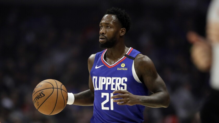 Clippers guard Patrick Beverley dribbles the ball during a game.