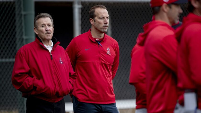 Angels owner Arte Moreno, left, and general manager Billy Eppler watch batting practice during spring training at Tempe Diablo Stadium on Feb. 18, 2019.