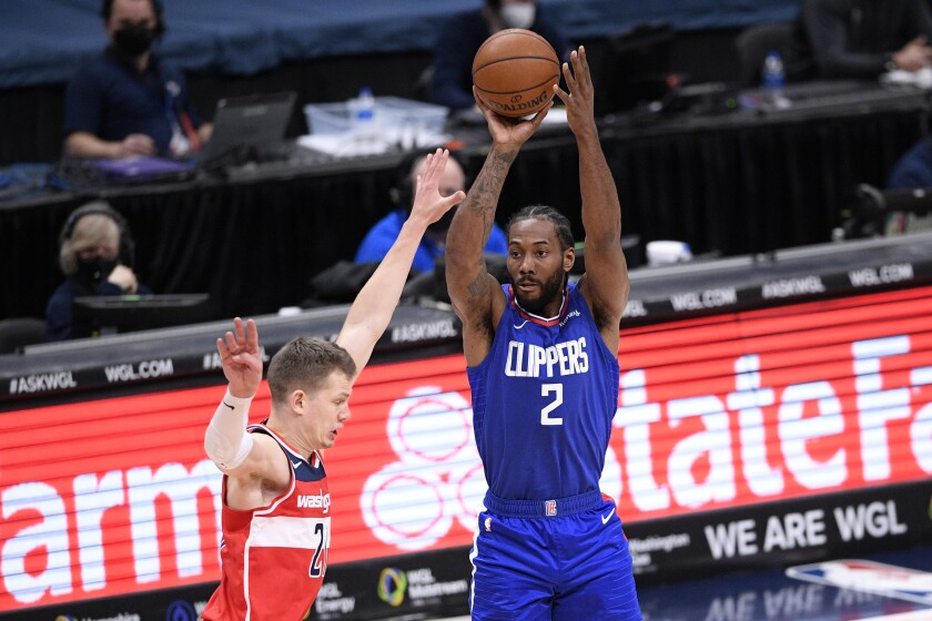 Los Angeles Clippers forward Kawhi Leonard (2) shoots against Washington Wizards center Moritz Wagner, left, during the second half of an NBA basketball game, Thursday, March 4, 2021, in Washington. (AP Photo/Nick Wass)