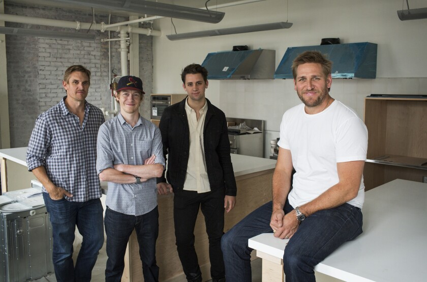Australian Chef Curtis Stone, right, and his brother Luke Stone will get the help of butchers Daniel Roderfeld, left-center, and Alex Jermasek, at Gwen's new upstairs test kitchen.
