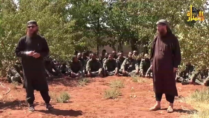 An image taken from a YouTube video released on Sept. 10 shows two Nusra Front leaders standing in front of captured U.N. peacekeepers.
