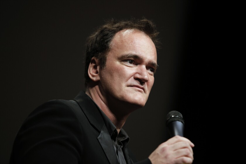 """Director Quentin Tarantino delivers a speech before receiving the Lumiere Award during the Lumiere Festival in Lyon, France. Tarantino sued Gawker Media on Monday in Los Angeles for copyright infringement over the site's posting of a story that linked to a leaked copy of his script for a planned film called """"The Hateful Eight."""""""