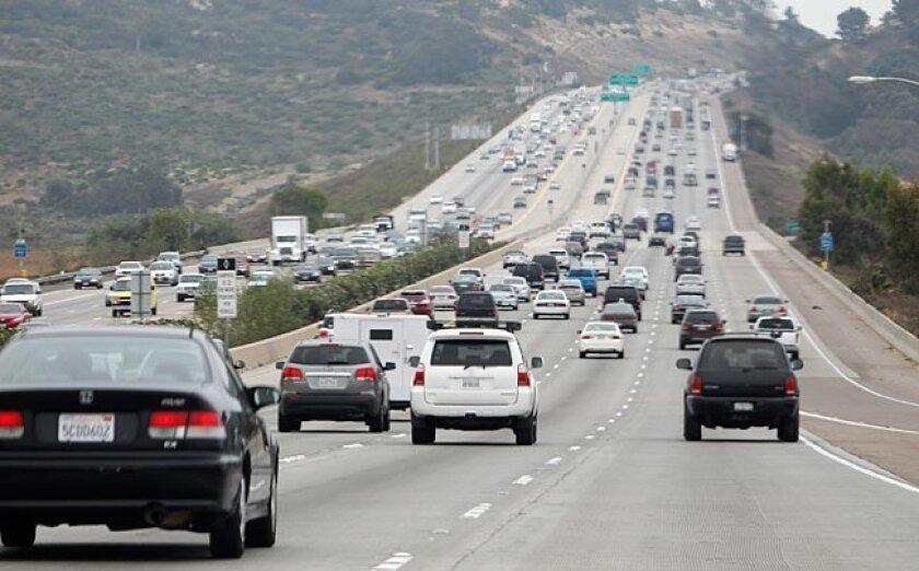 Traffic heads south on Interstate 5 past Via De La Valle.