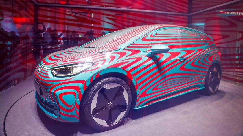 A Volkswagen ID.3 electric car is seen in a glass enclosure during a press conference in Berlin on May 8.