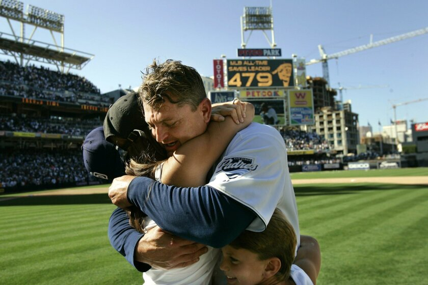 Padres reliever Trevor Hoffman broke the all-time record for saves against the Pittsburgh Pirates on Sunday, Sept. 24, 2006, at Petco Park in San Diego, CA. He is shown here hugging his wife Tracy and son Quinn after the game.
