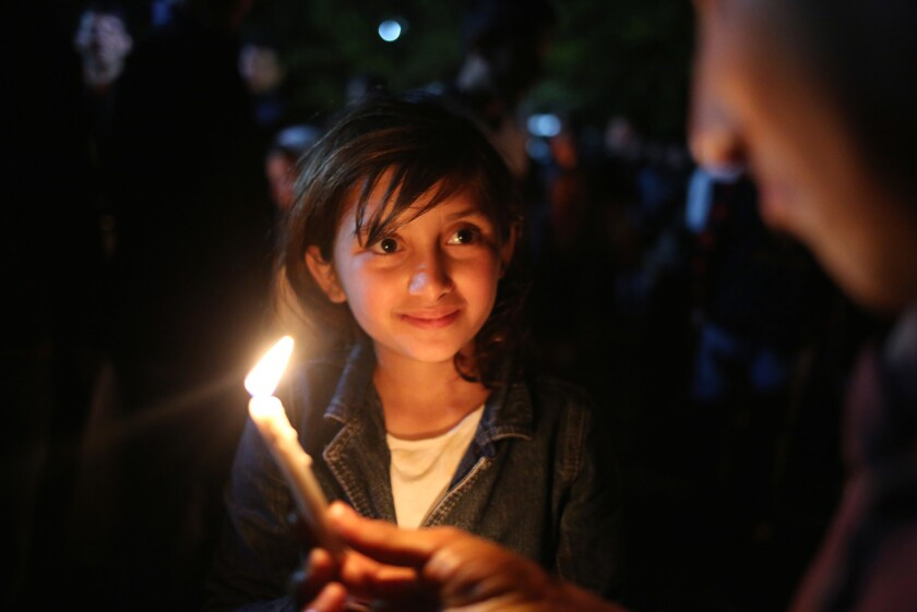 A young girl participates in a Yazidi New Year celebration at a shrine near Mosul in 2015.