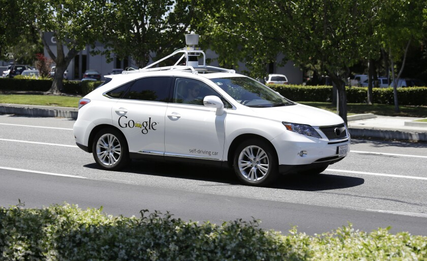 Google says reports that one of its self-driving cars and a Delphi self-driving car had a close call were untrue.