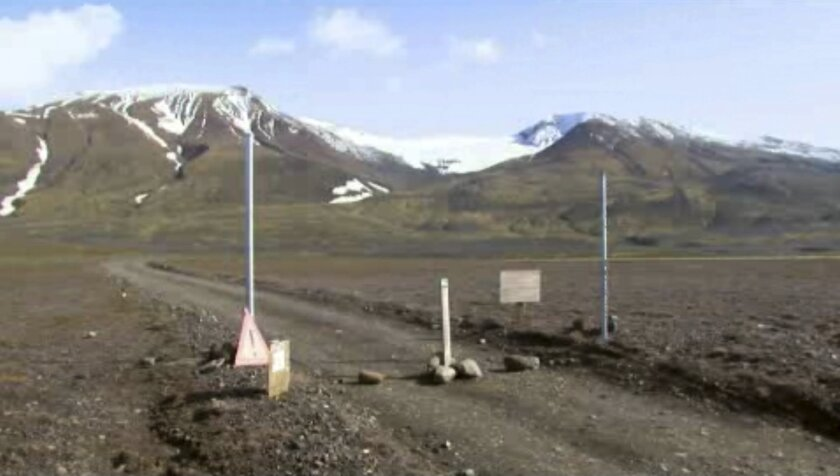 FILE - This is a Aug. 19, 2014 file image taken from video of a sign is posted on the road next to Bardarbunga, a subglacial stratovolcano located under Iceland's largest glacier. Earthquakes are rocking Iceland's Bardarbunga volcano, adding to concerns that magma movements may trigger an eruption that could hinder air traffic. Iceland's Met Office says two earthquakes measuring over magnitude 5 shook the volcano under the vast Vatnajokull glacier on Wednesday Aug. 27 2014. Some 500 quakes have hit the area since midnight. (AP Photo/Courtesy Channel 2 Iceland, File) ICELAND OUT