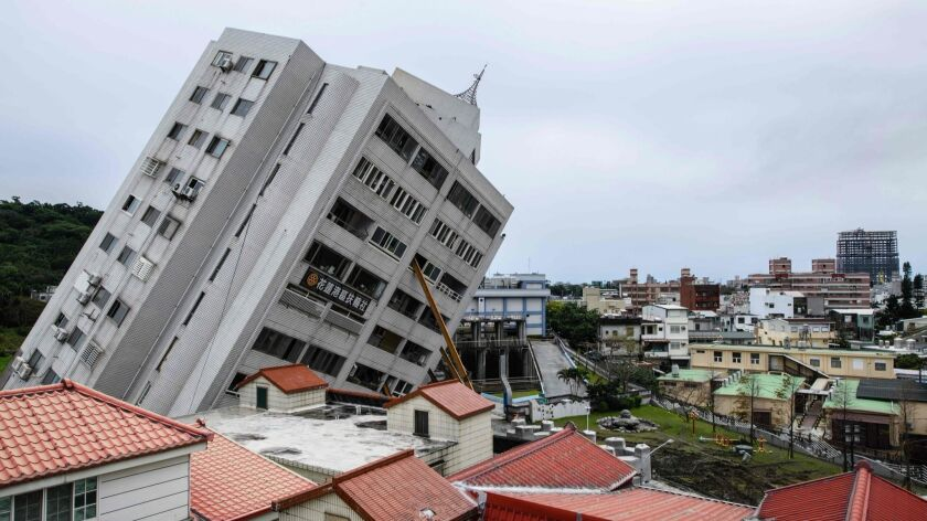 The 12-story Yun Tsui building leans precariously after partially collapsing when a magnitude 6.4 earthquake struck the Taiwanese city of Hualien on Feb. 6. The capital, Taipei, had 11 seconds of warning broadcast on television before the shaking started.