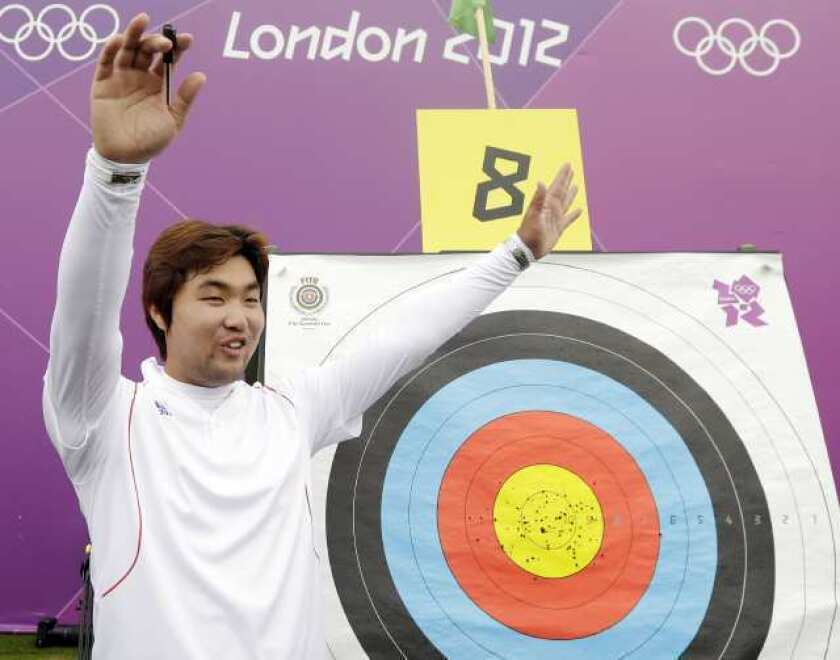 South Korea's Im Dong-hyun celebrates his world record.