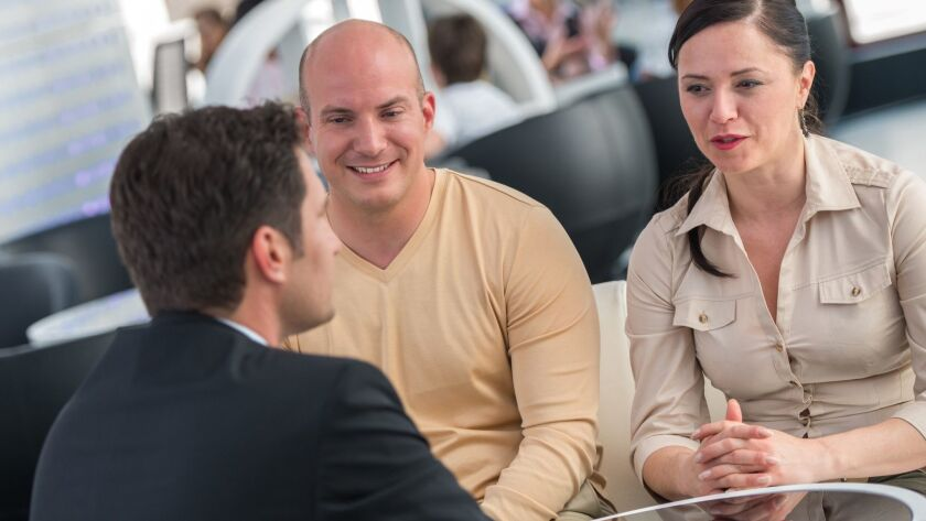 Financial Advisor Talking With His Clients. Getty images photo ** TCN OUT **