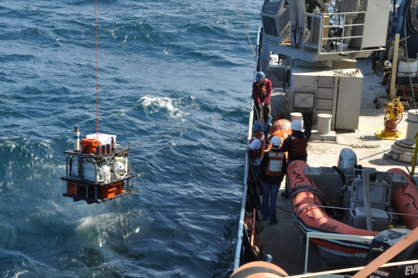 Scientists retrieve instruments used to collect samples of water from the undersea aquifer in the ocean's crust