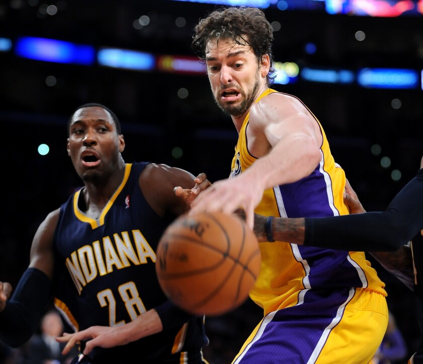 Lakers center Pau Gasol battles for a loose ball with Indiana Pacers center Ian Mahinmi during the Lakers' 104-92 loss at Staples Center.