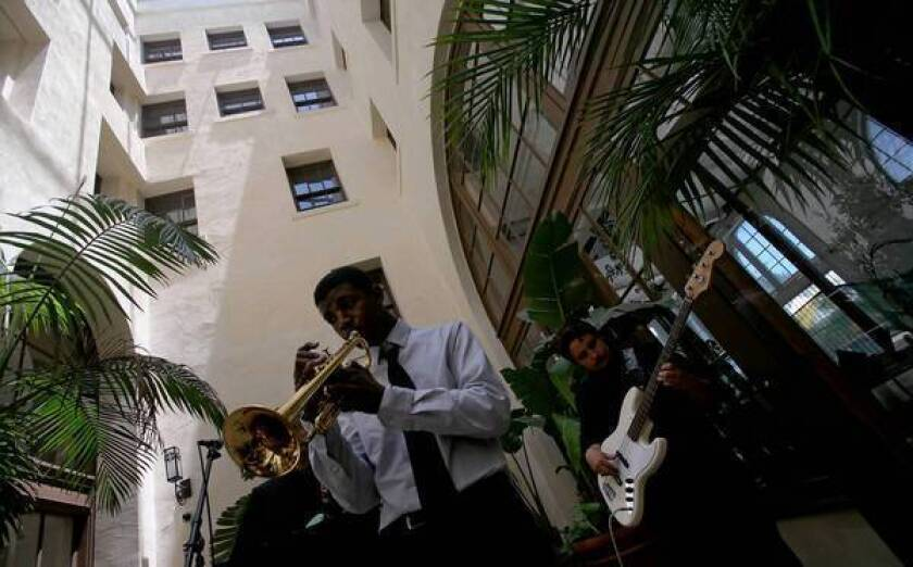 Nile Seabrooks, 17, left, and Gustavo Puga perform in the atrium of the historic Dunbar Hotel during the 18th annual Central Avenue Jazz Festival.