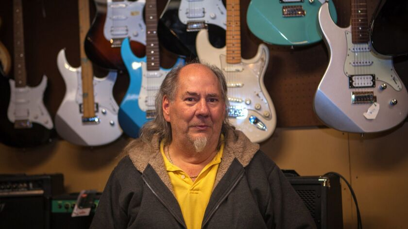 Philip Stidham, drummer, instrument repairman, music store owner and drummer in a Christian Rock Ban