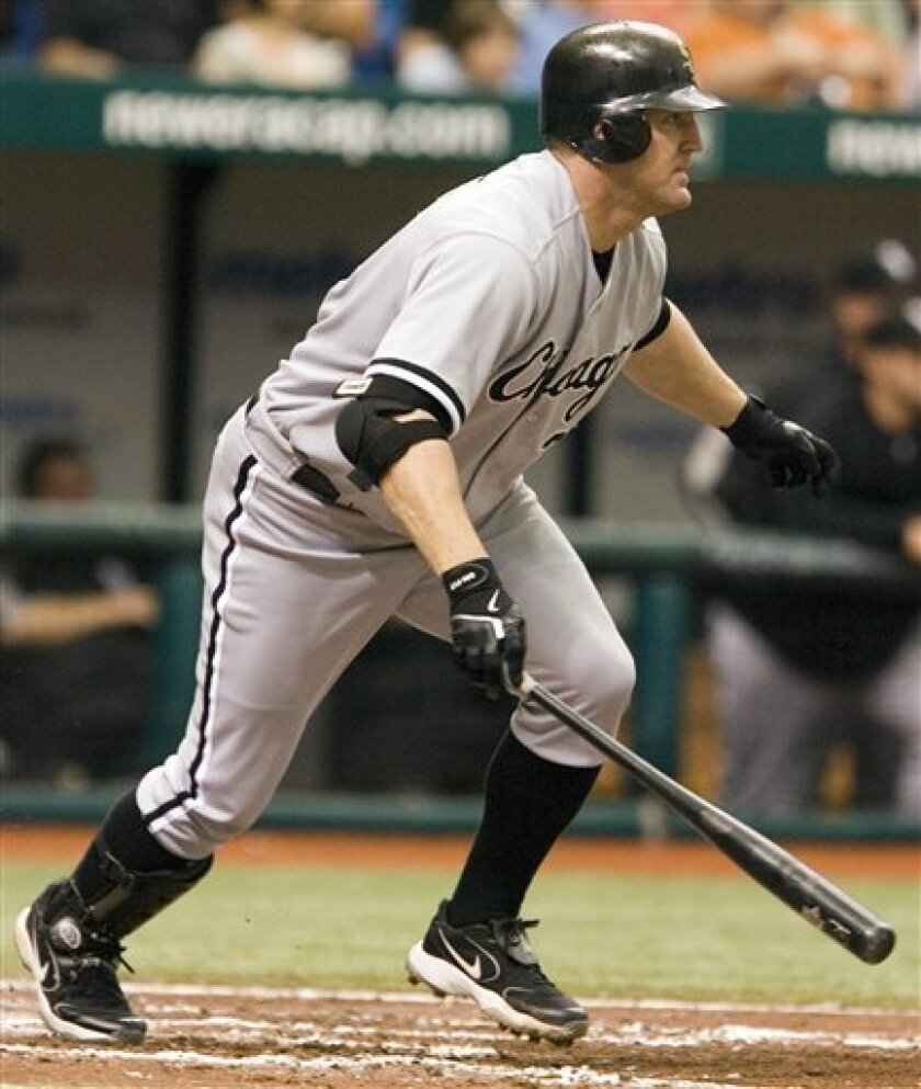 Chicago White Sox designated hitter Jim Thome hits an RBI-single during the fifth inning of a baseball game against the Tampa Bay Rays on Sunday, April 20, 2008, in St. Petersburg, Fla. (AP Photo/Joe Ranze)