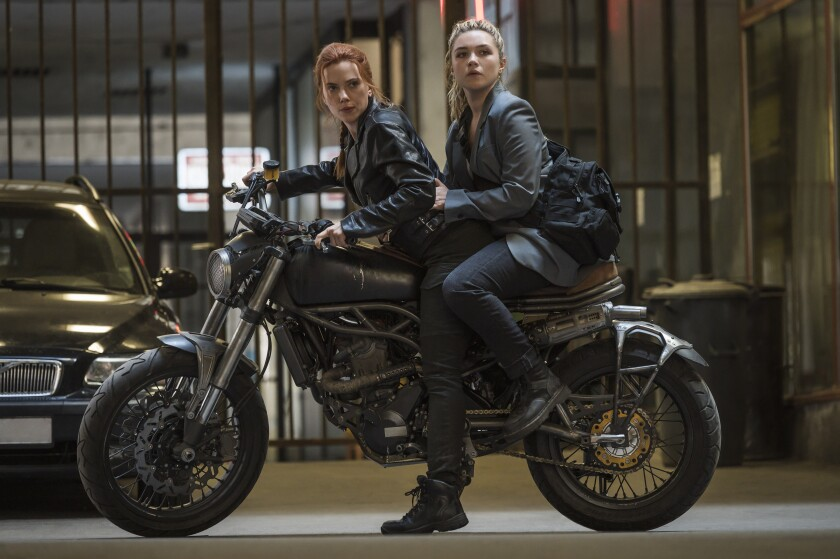 """Scarlett Johansson and Florence Pugh on a motorcycle in the film """"Black Widow."""""""