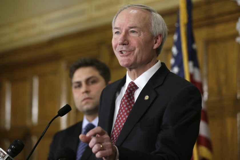 Arkansas Gov. Asa Hutchinson answers reporters' questions at the state Capitol in Little Rock on Wednesday.