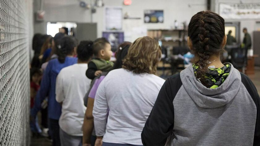 Migrant families wait to be processed at the United States Border Patrol Processing Center in McAllen, Texas.