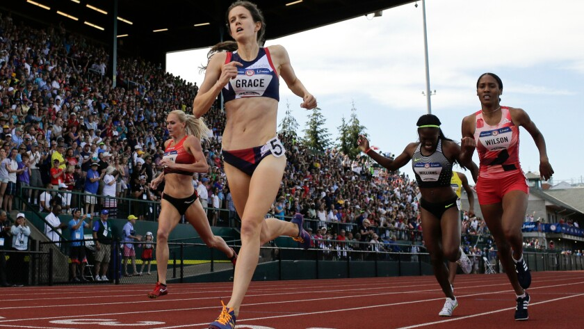 Kate Grace wins the women's 800-meter final at the Olympic track and field trials in Eugene, Ore. The International Olympic Committee prevents brands that aren't major sponsors -- such has Grace's apparel provider, Oiselle -- from referring to the Olympics in ads.