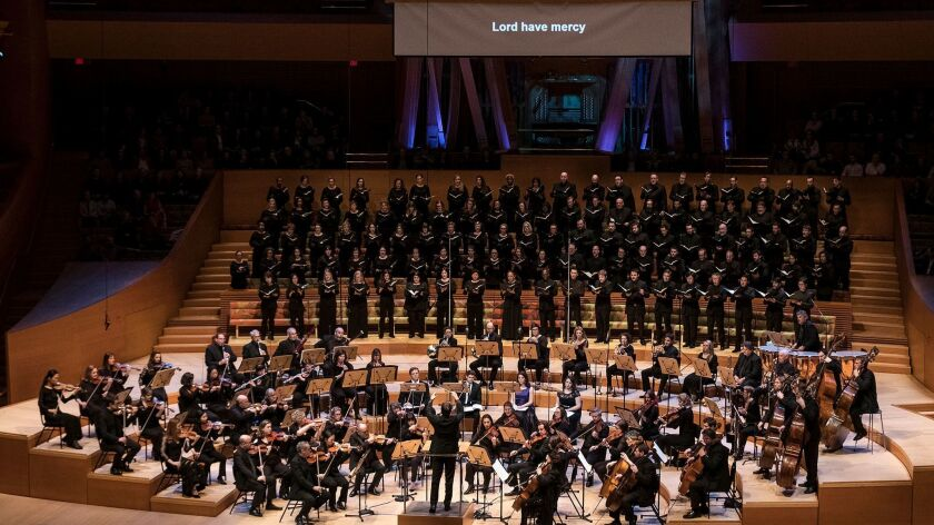 """Grant Gershon conducts the Master Chorale while supertitles translate Beethoven's """"Missa Solemnis"""" at Disney Hall."""