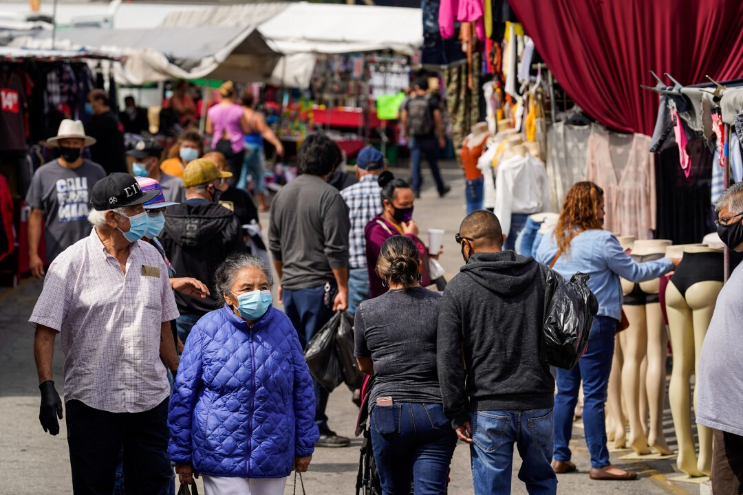 People going to the Santa Fe Springs Swap Meet are required to wear masks and maintain proper social distancing.