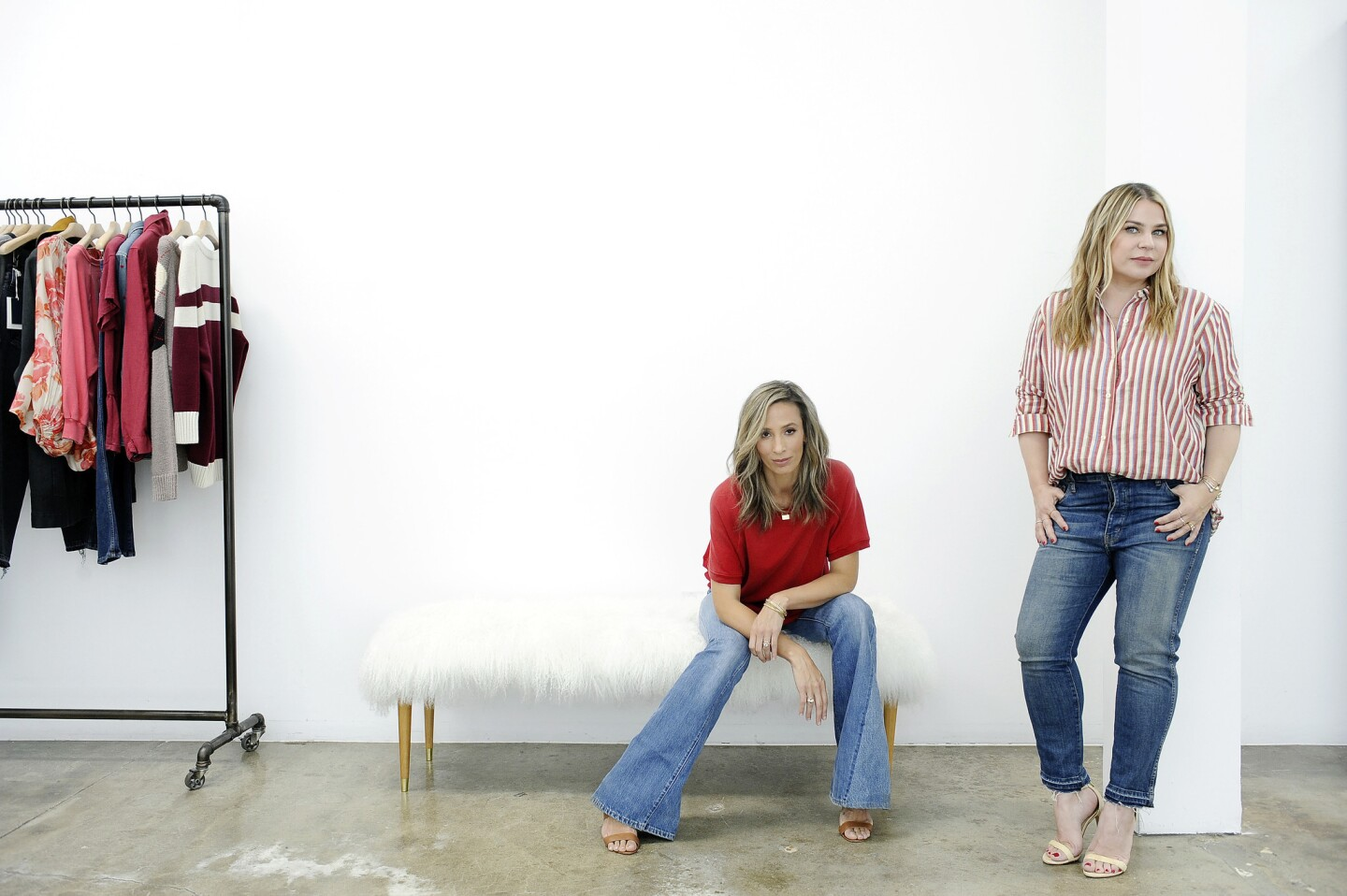 Meritt Elliott, left, and Emily Current in their showroom and studio.