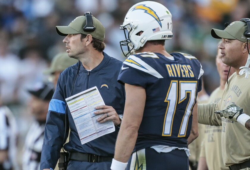 Chargers play-caller Shane Steichen stands next to quarterback Philip Rivers on the sideline during a 26-11 win over the Green Bay Packers on Sunday.