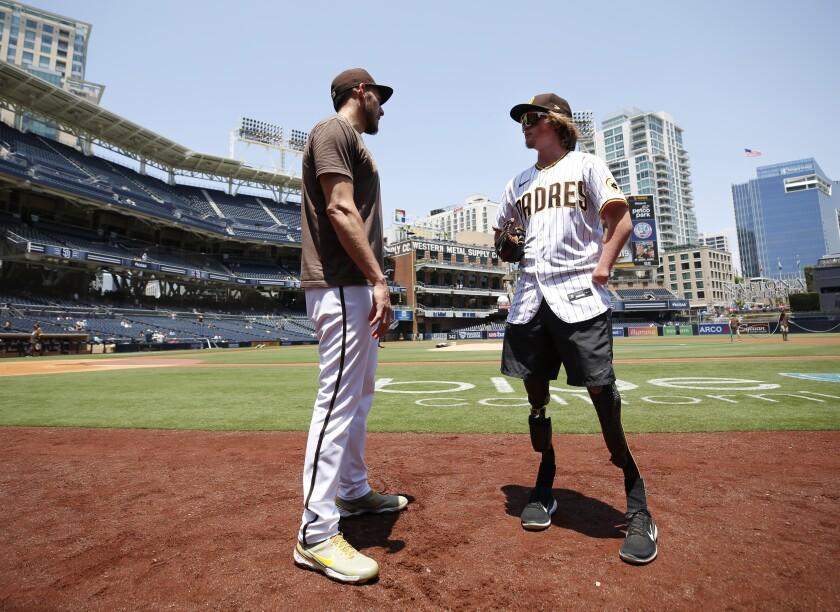 Padres' pitcher Joe Musgrove talks with Landis Sims