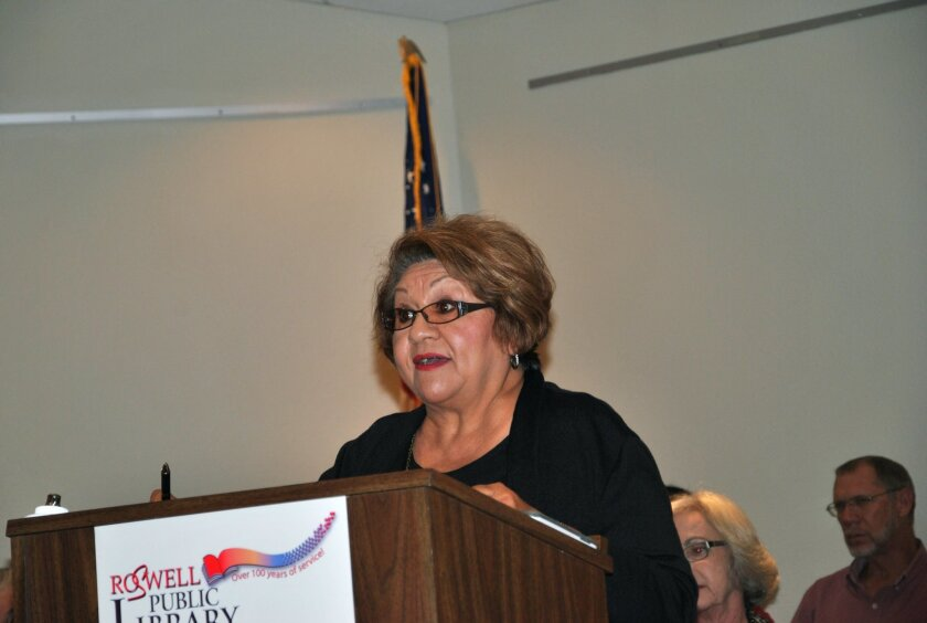 In this photo taken on Tuesday, Oct. 27, 2015, Virginia E. Garcia speaks at a meeting in Roswell, N.M., in favor of naming streets after civil rights icons Cesar Chavez and Martin Luther King Jr. (Jeff Tucker/Roswell Daily Record via AP) MANDATORY CREDIT