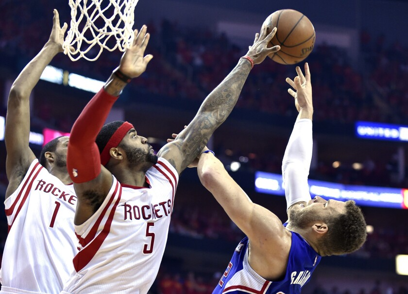 Rockets forward Josh Smith (5) blocks a shot by Clippers forward Blake Griffin in the first half of Game 7 on Sunday.