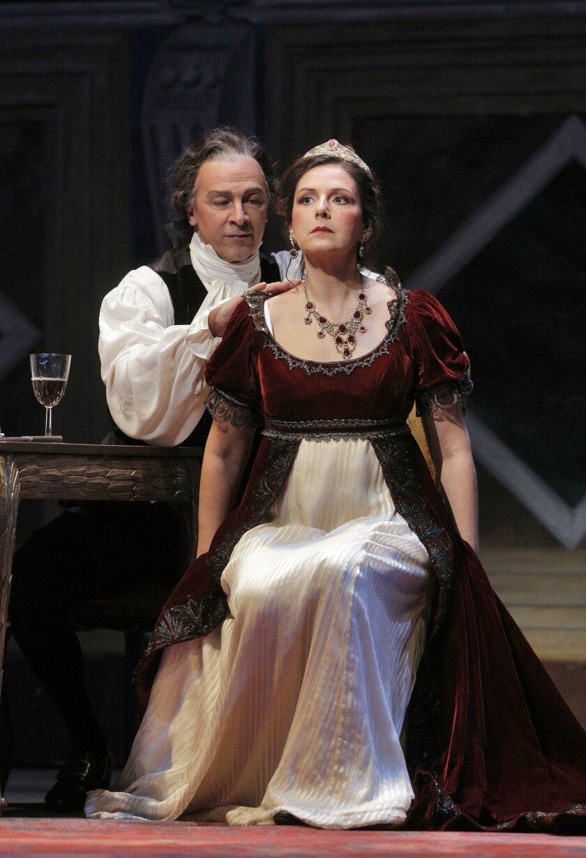 "Greer Grimsley as Baron Scarpia and Alexia Voulgaridou as Floria Tosca in San Diego Opera's ""Tosca."""