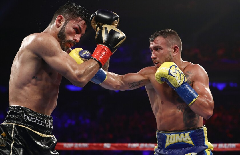 Vasiliy Lomachenko punches Jorge Linares during their WBA lightweight title fight at Madison Square Garden on May 12, 2018 in New York City.