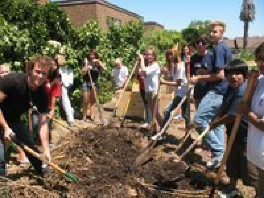 Shoveling compost at the North County Community Garden