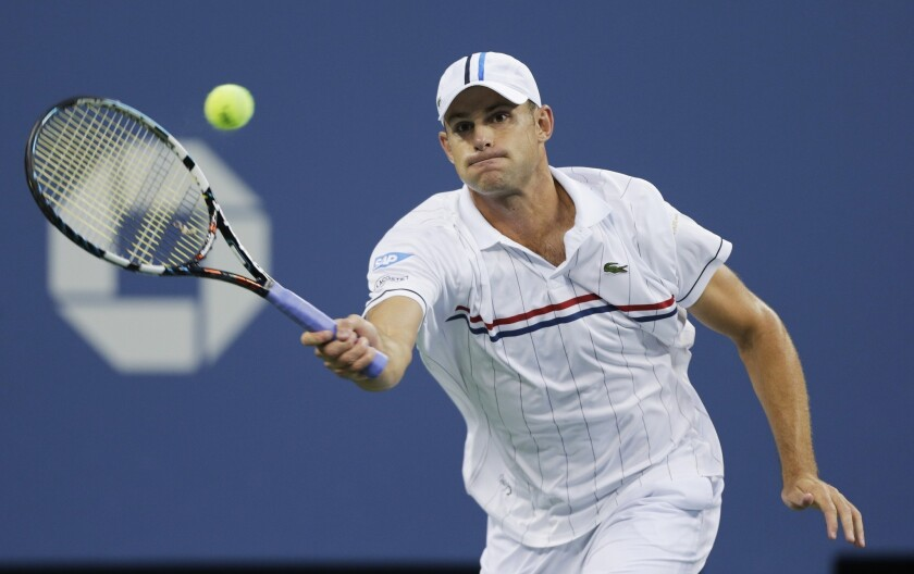 Andy Roddick returns a shot to Australia's Bernard Tomic in the third round of play at the 2012 US Open tennis tournament.