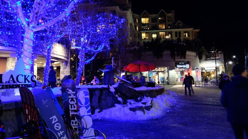 Whistler's paved, pedestrian-only Village Stroll twinkles at night. Benjamin Myers photo