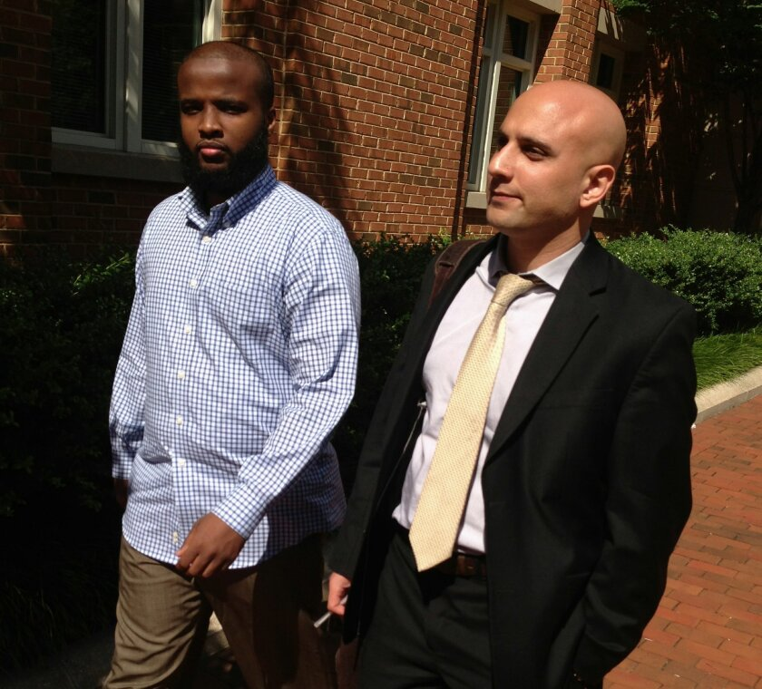 DELETES REFERENCE TO GADEIR ABBAS ASSOCIATION TO THE COUNCIL ON AMERICAN-ISLAMIC RELATIONS - FILE - In this Aug. 16, 2013, file photo, Gulet Mohamed, left, leaves the federal court in Alexandria, Va. with his attorney, Gadeir Abbas, after a hearing challenging his placement on the government's no f